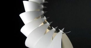 The repetitive design using paper folded up is using the various properties of p...
