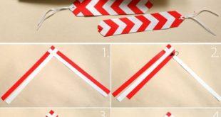Für dieses Lesezeichen werden Papierstreifen geflochten ...