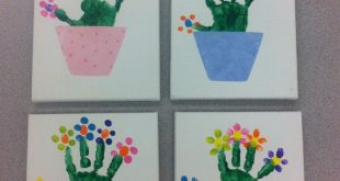 Handprint with fingerprint flowers on canvas. Flower pots were cut from scrapboo
