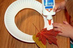 Your kids will love making their own leaf wreaths for fall! Simply cut a hole ou...